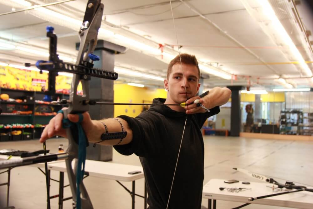 Man shooting archery compound bow