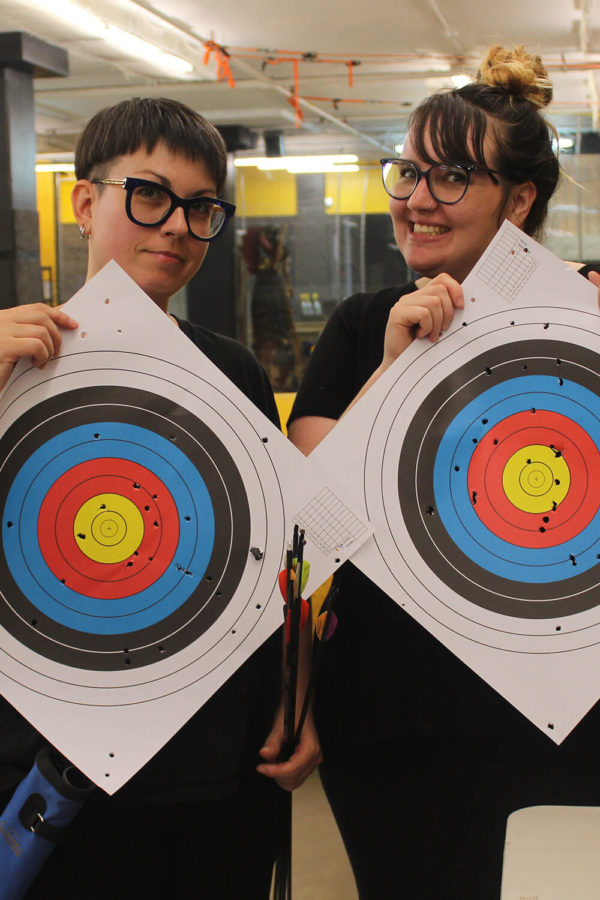 beginner archery students holding targets